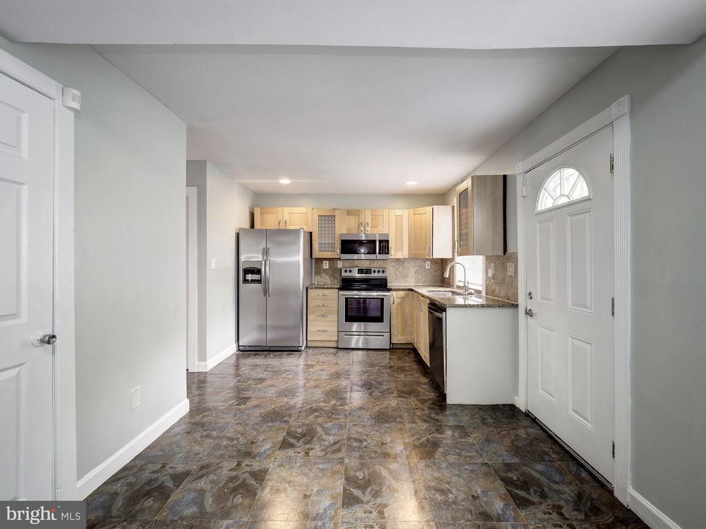 Kitchen floor. - 5108 D ST SE, WASHINGTON