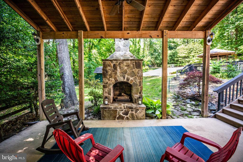Outdoor Stone fireplace in hot tub area - 2720 BROOKE RD, STAFFORD