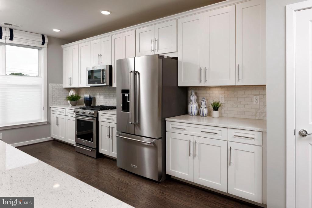 Kitchen  - Photo is for illustrative purposes only - 11200 RESTON STATION BLVD #301, RESTON