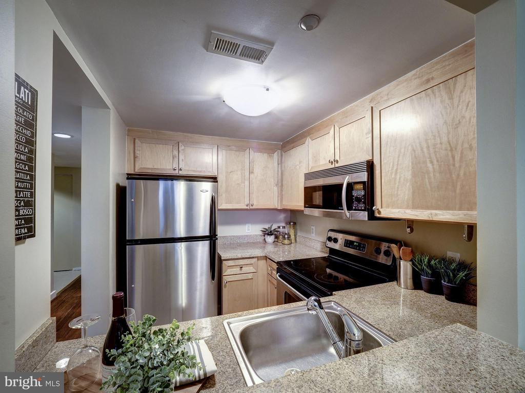 Pass through opens up kitchen to living space - 1150 K ST NW #309, WASHINGTON