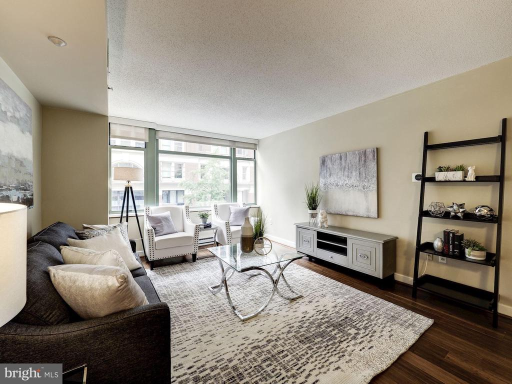 West facing wall of windows in living room - 1150 K ST NW #309, WASHINGTON