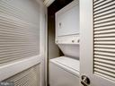 Stacked washer + dryer in hall. - 1150 K ST NW #309, WASHINGTON