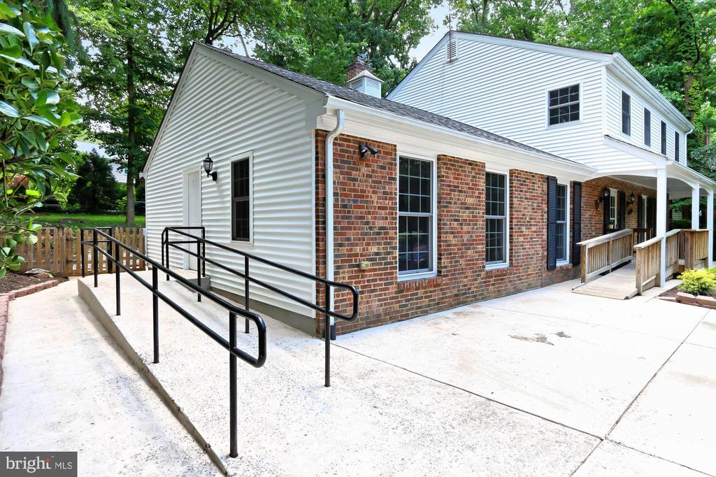 Concrete ramp to side door - handicap accessible - 8303 BOTSFORD CT, SPRINGFIELD