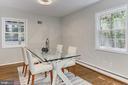 Dining room has modern light fixture - 8303 BOTSFORD CT, SPRINGFIELD