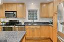 Granite counters and stainless steel appliances - 8303 BOTSFORD CT, SPRINGFIELD