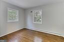 Upper level bedroom. Refinished hardwood floors. - 8303 BOTSFORD CT, SPRINGFIELD