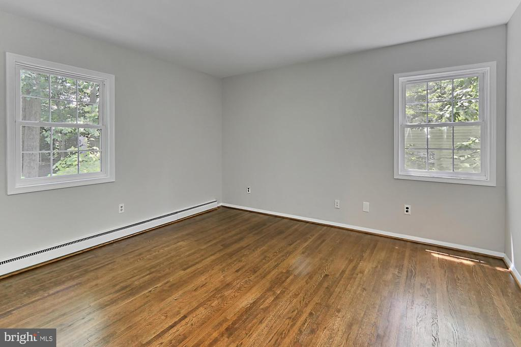 Upper level bedroom. Refinished hardwoods. - 8303 BOTSFORD CT, SPRINGFIELD