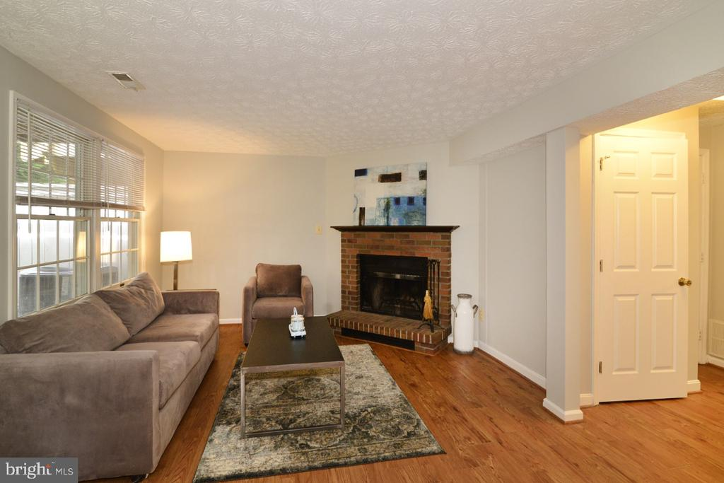 Lower Family Room Features Wood Burning Fireplace - 1560 TWISTED OAK DR, RESTON