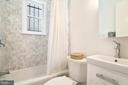 Unit 2 renovated bathroom with marble tile - 1009 O ST NW, WASHINGTON