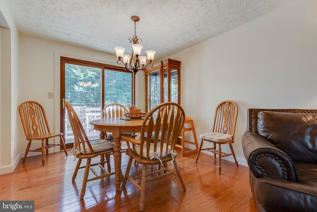 Dining Room with Updated Lighting - 4420 CUB RUN RD, CHANTILLY