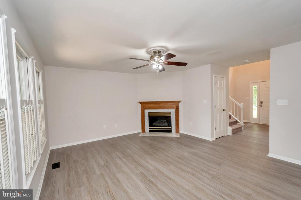 Family Room w/ Gas Fireplace & Plantation Shutters - 5021 QUEENSBURY CIR, FREDERICKSBURG