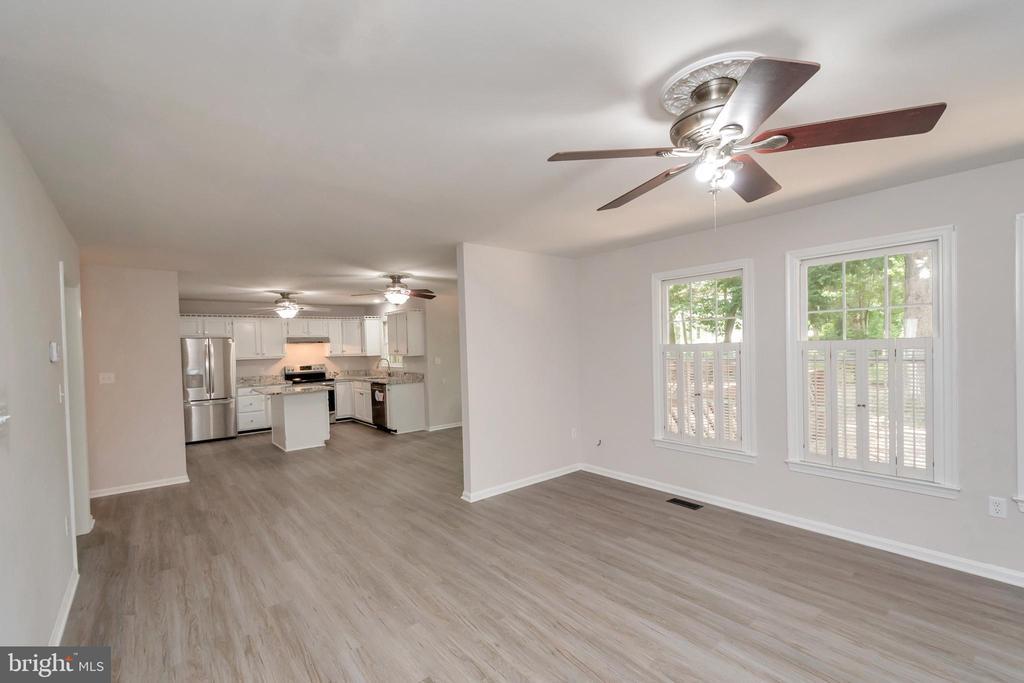 Family Room w/ Gas Fireplace & Plantation Shutters - 5021 QUEENSBURY CIR, FREDERICKSBURG
