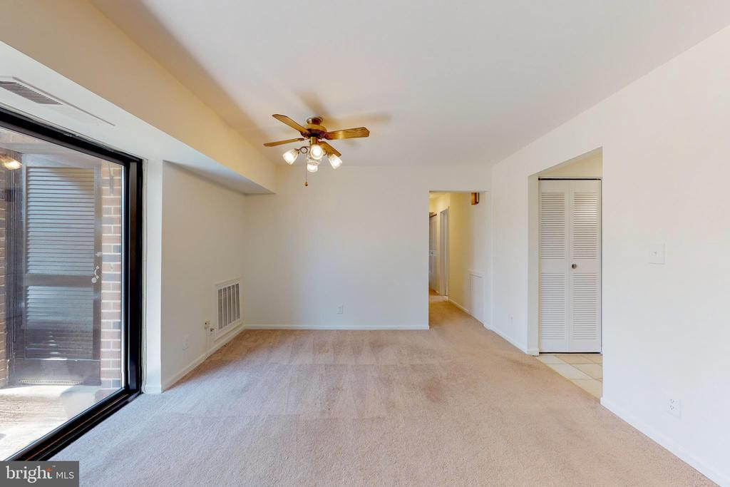 Ceiling fan over the separate dining area - 7806 DASSETT CT #203, ANNANDALE