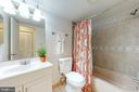 Updated hall bath with new toilet and lighting - 7806 DASSETT CT #203, ANNANDALE