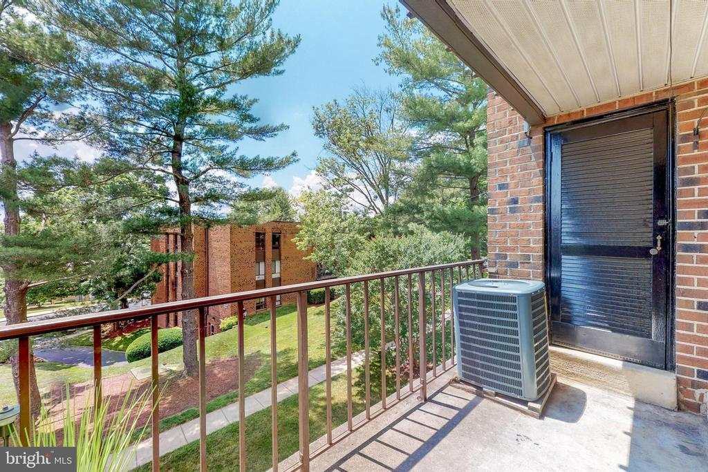 View from balcony & door to storage/utility closet - 7806 DASSETT CT #203, ANNANDALE