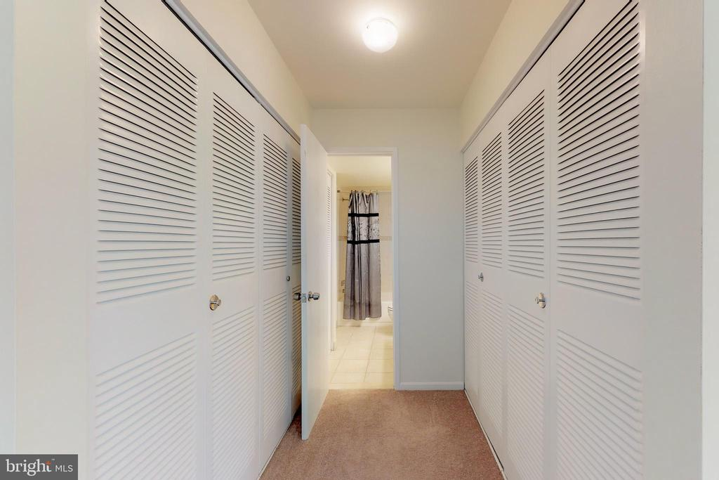 His and Hers closets in the master suite - 7806 DASSETT CT #203, ANNANDALE