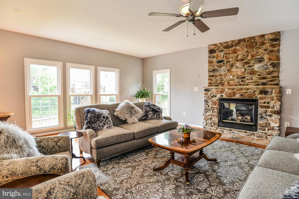 Floor to Ceiling Stone Fireplace - 5713 REGAL CREST CT, CLIFTON
