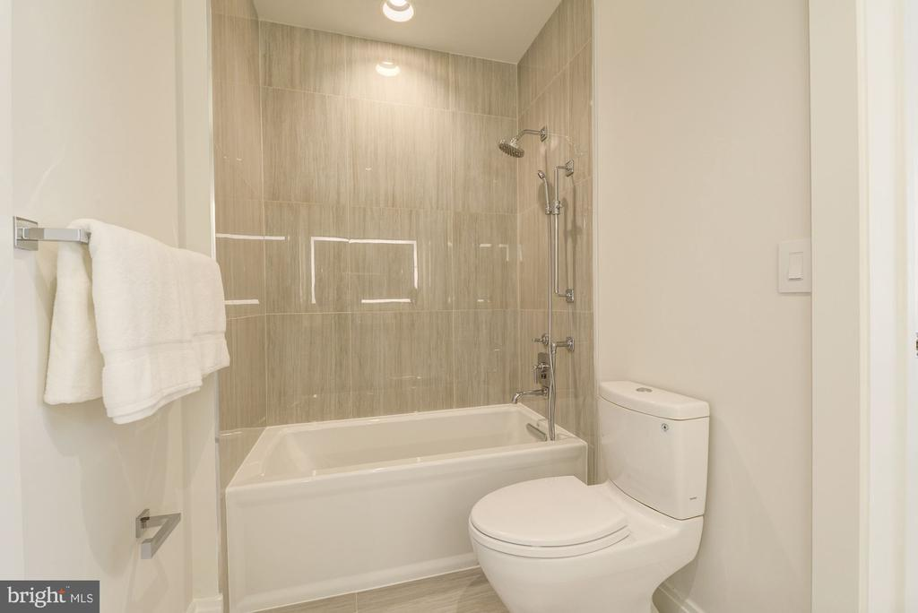 and a large soaking tub with Waterworks fixtures - 1427 RHODE ISLAND AVE NW #PH3, WASHINGTON