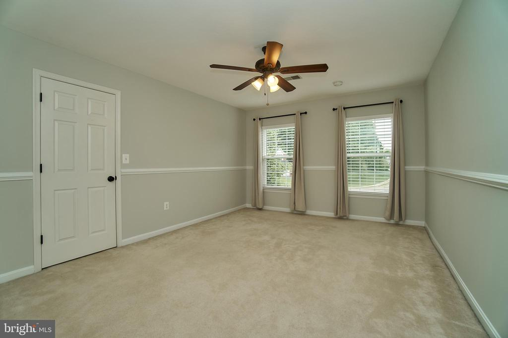 4th bedroom with chair rail - 9216 ZACHARY CT, MANASSAS PARK