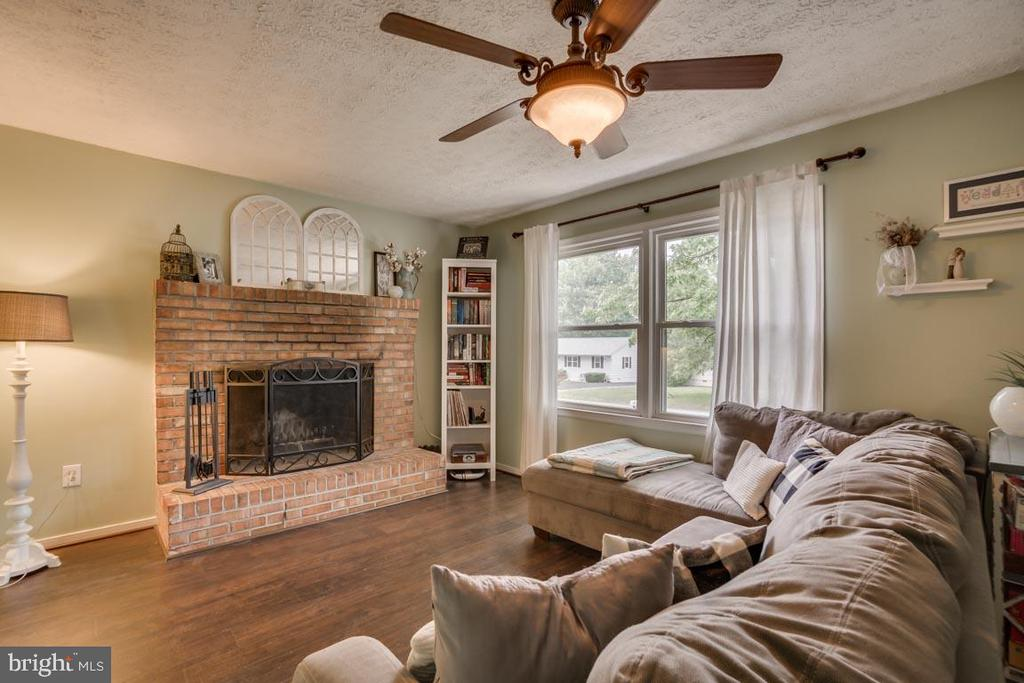 Cozy fireplace in the living room - 5509 CAROUSEL ST, FREDERICKSBURG