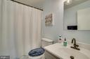 Renovated bathroom with tile flooring - 5509 CAROUSEL ST, FREDERICKSBURG