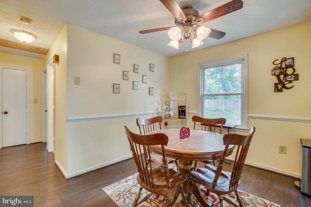 Dining Room with laminate wood flooring - 5509 CAROUSEL ST, FREDERICKSBURG