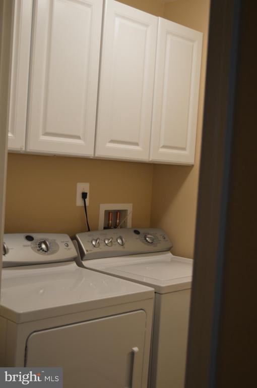 Washer and dryer with cabinets - 210 MONROE POINT DR, COLONIAL BEACH