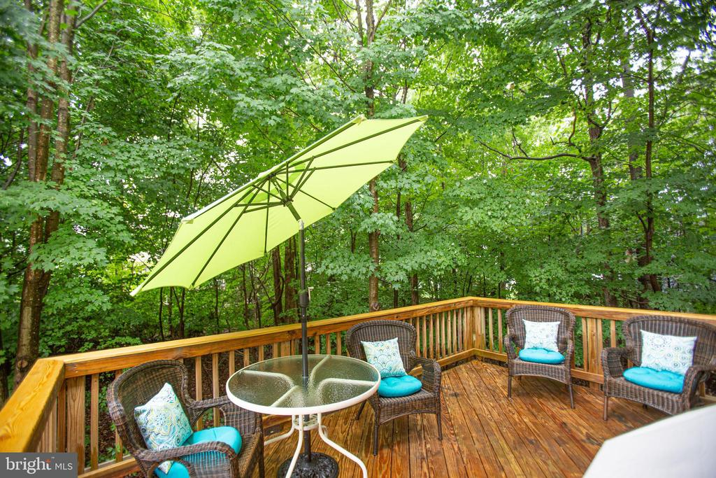 Deck with a green backdrop - 8539 BERTSKY LN, LORTON
