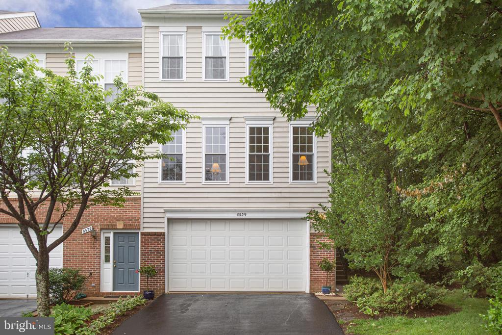 2-Car garage w 4-car driveway.  All those windows! - 8539 BERTSKY LN, LORTON