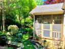 Tranquil backyard space with screened-in porch - 4412 WALSH ST, CHEVY CHASE