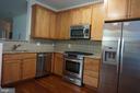 Granite & Hardwood completes the kitchen - 11750 OLD GEORGETOWN RD #2135, ROCKVILLE