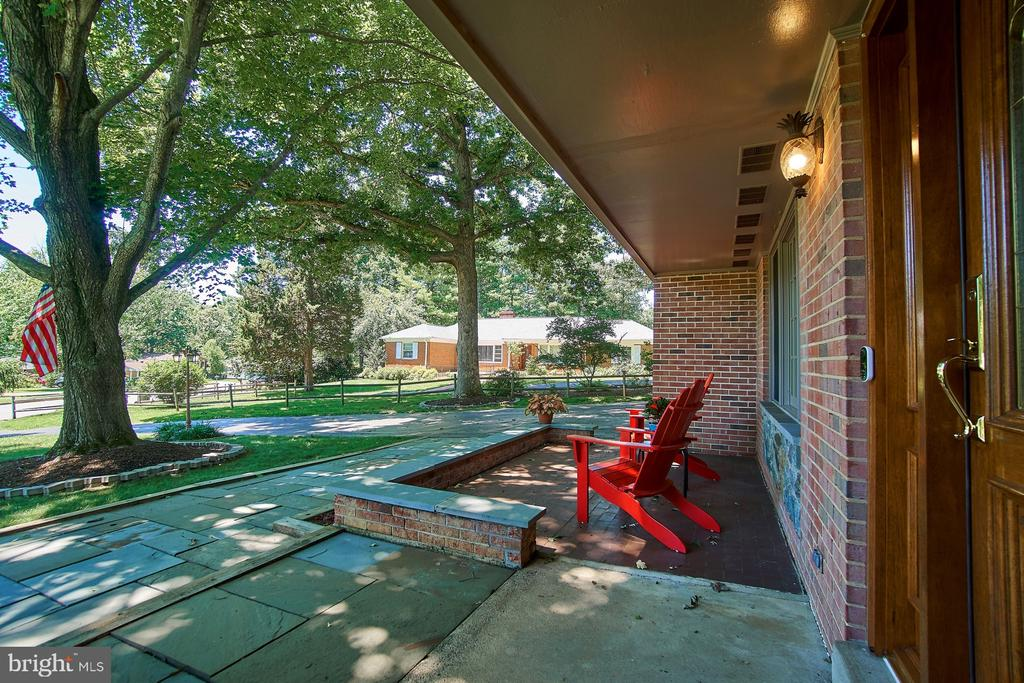 Peaceful views await on a blue stone front patio - 8502 TYSONS CT, VIENNA