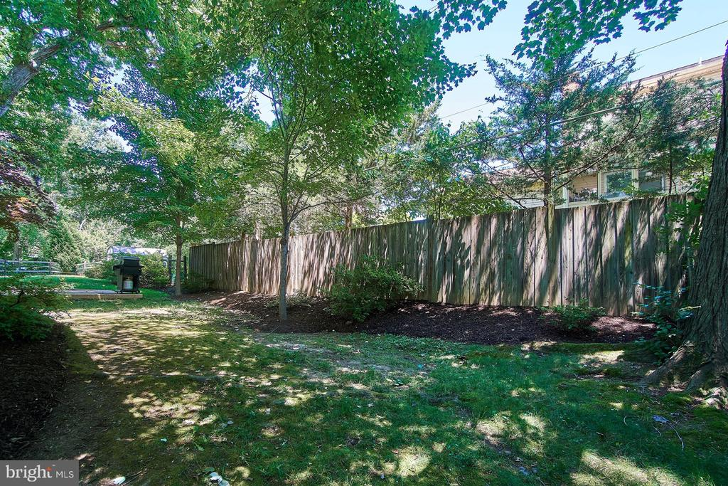 Backyard includes patio, shed, and plenty of grass - 8502 TYSONS CT, VIENNA