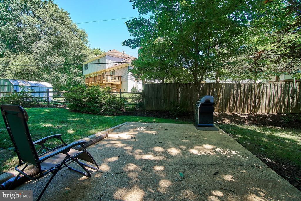 Backyard has plenty of patio, yard space - 8502 TYSONS CT, VIENNA