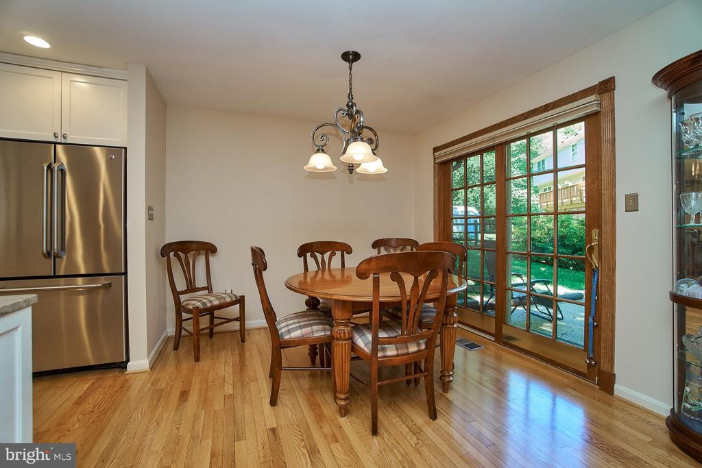 Open dining area with sliding doors to backyard - 8502 TYSONS CT, VIENNA