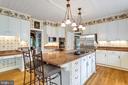 Center Island with 6-burner Viking Cooktop. - 11256 WAPLES MILL RD, OAKTON