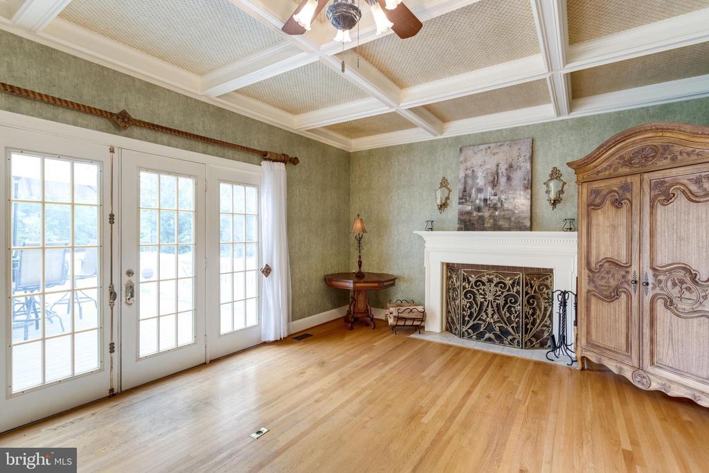 Family Room has Wood-burning Fireplace. - 11256 WAPLES MILL RD, OAKTON
