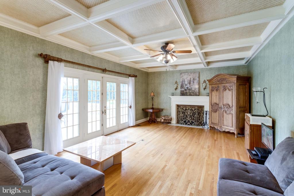 Family Room has Double Doors that open to Deck - 11256 WAPLES MILL RD, OAKTON