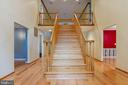 Two story foyer with oak staircase - 98 WATEREDGE LN, FREDERICKSBURG