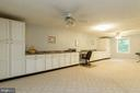 Built in cabinets to provide a basement work space - 98 WATEREDGE LN, FREDERICKSBURG