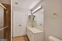 Bathroom with Doors to Laundry In View - 11701-B KARBON HILL CT #502B, RESTON