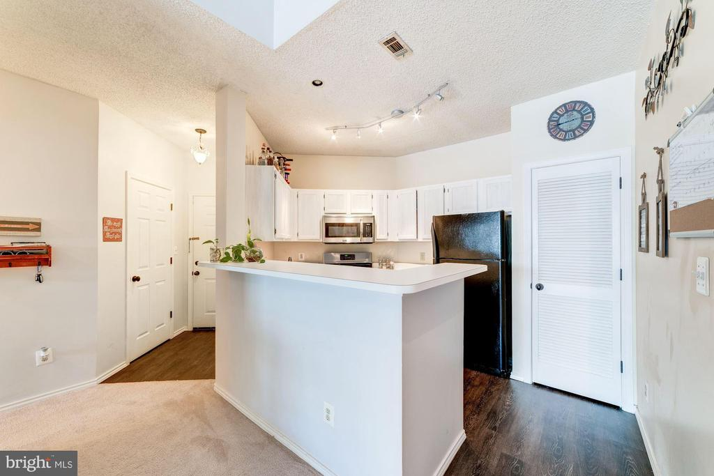 Kitchen Opens Beautifully to Living Room - 4404 HELMSFORD LN #203, FAIRFAX