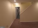 Bottom of basement stairs - 12302 HUNGERFORD MANOR CT, MONROVIA