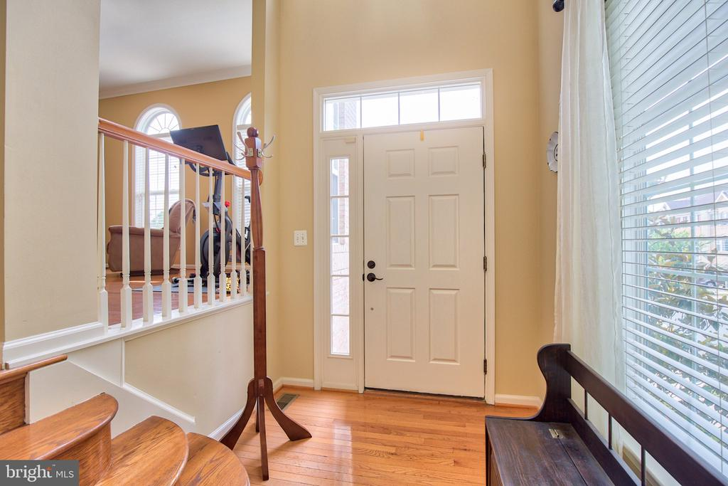 Enter your new home through a 2 story foyer. - 18309 MILL RIDGE TER, LEESBURG