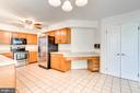 Open Kitchen with Ceramic Floors, Corian Counters - 2235 AQUIA DR, STAFFORD
