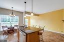 Kitchen overlooking Family Room - 5185 BALLYCASTLE CIR, ALEXANDRIA
