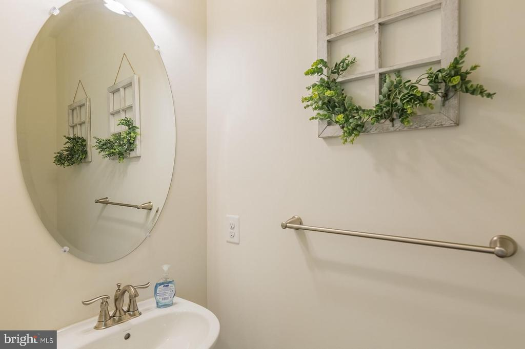 There is a half bath in the family foyer - 17152 GULLWING DR, DUMFRIES