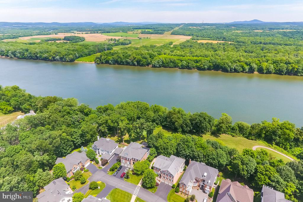 Aerial View of house, golf course & Potomac River - 18192 SHINNIECOCK HILLS PL, LEESBURG
