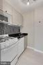 Granite counters and tile backsplash - 1021 ARLINGTON BLVD #419, ARLINGTON