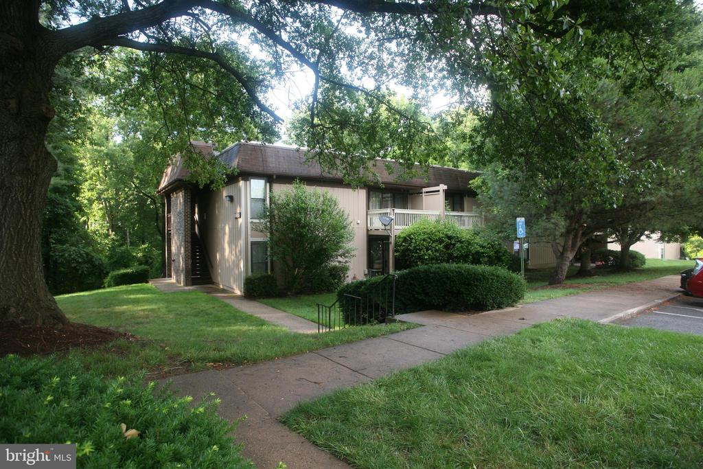 Exterior with well-maintained grounds - 5818 ROYAL RIDGE DR #Q, SPRINGFIELD